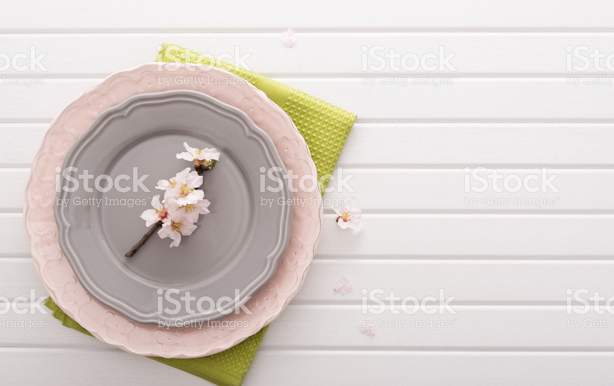 Top view on table with plates and flowers